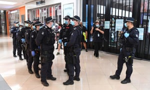 Police patrol through the Chadstone shopping centre after an anti-lockdown protest on 20 September 20.