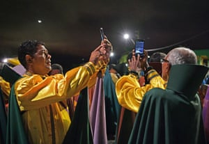 Devotees take selfies during their biggest ceremony of the year at their temple complex
