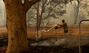 Trevor Colliss fights the fire at Kulnara, near Mangrove mountain, NSW. 6 December 2019