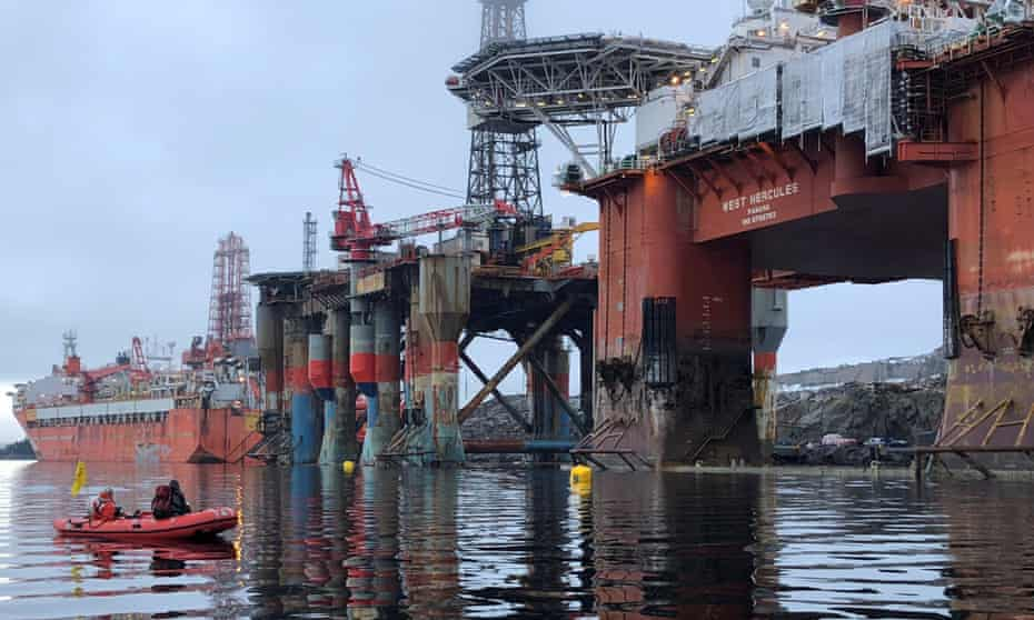 Greenpeace activists board an oil rig in a fjord off the west coast of Norway last year