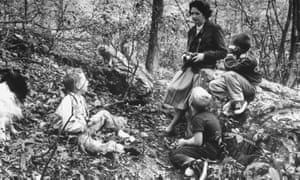 Rachel Carson with children and dog in woods near her home.