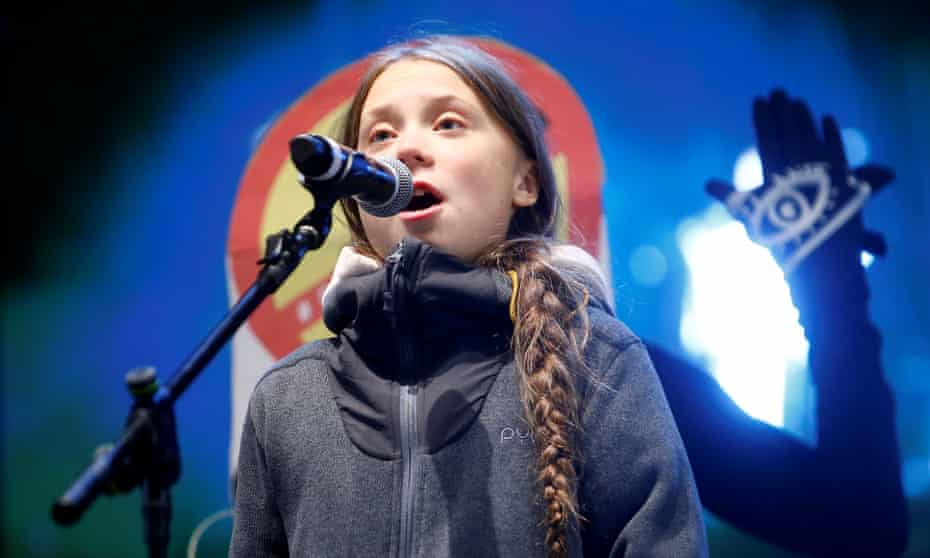 Climate change activist Greta Thunberg delivers a speech at a climate change protest march.