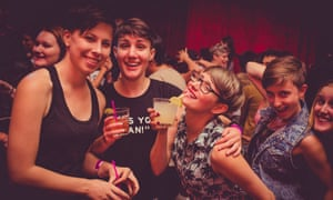 Four women pose for the camera at an event at Cockblock, San Francisco, California.