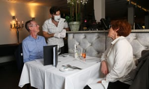 Valentin Pellet, host at Claire's Kitchen in Darlinghurst, chats to diners in his restaurant on Friday
