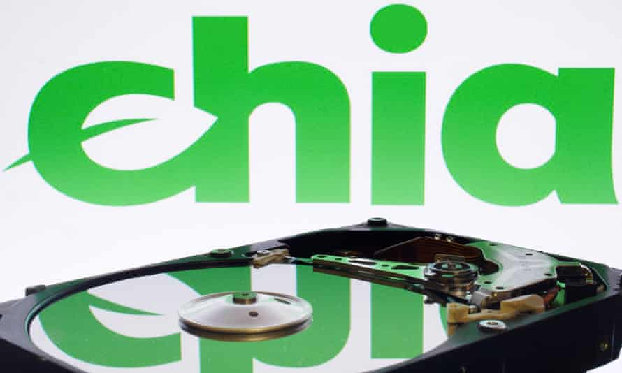 The Chia logo reflected in the plate of a computer hard disk