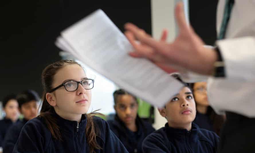 children looking at teacher with script