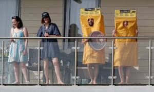 On the balcony of a flat overlooking the County Ground in Bristol, a couple dressed up in sandpaper costumes watch the match between Afghanistan and Australia.