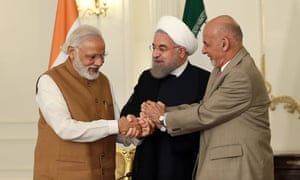 Narendra Modi (left) holds hands with the Iranian president, Hassan Rouhani (centre) and his Afghan counterpart, Ashraf Ghani, in Tehran.