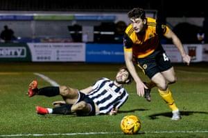 Max Kilman of Wolverhampton Wanderers goes past Harry Cardwell of Chorley.
