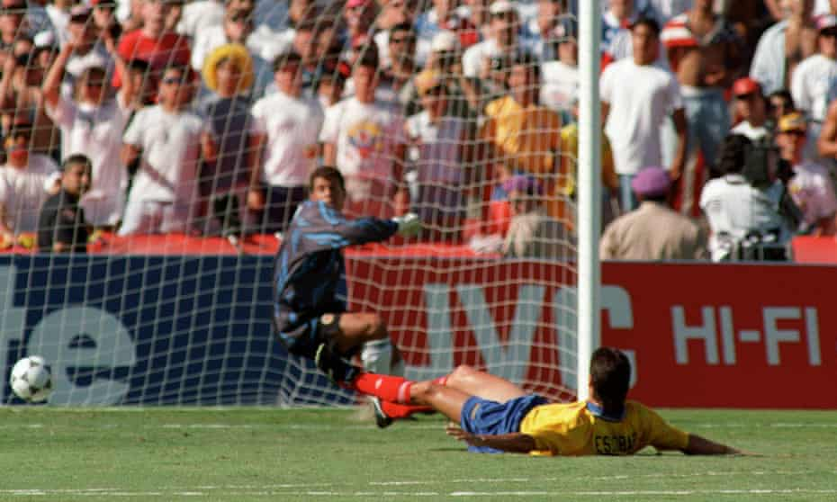 Colombia's captain, Andrés Escobar, lies on the ground after scoring an own goal at USA 94. The following month, he was shot dead.
