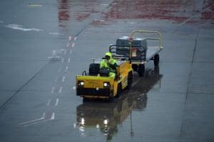 Sydney airport ground crew in the rain