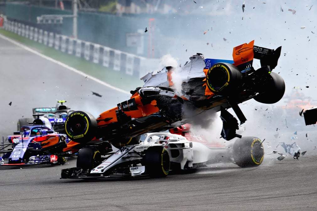 Best photos of the day: a flying F1 car and a storm surfer