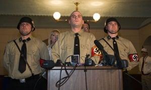 Neo-Nazi leader Jeff Schoep (centre)