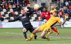 Glenn Morris of Crawley Town saves a shot from Joss Labadie of Newport County.