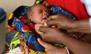A baby is vaccinated in Africa.