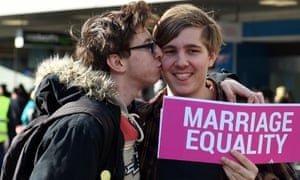 Pro-gay marriage supporters at a rally in Sydney on 25 June .