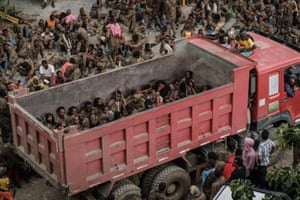 Wounded Ethiopian soldiers arrive on a truck at the rehabilitation centre.