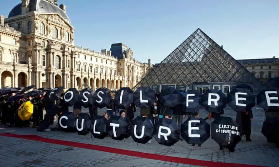 Climate activists stage a protest outside the Louvre pyramid in Paris where negotiations are taking place to agree a global deal on greenhouse gas emissions<br>