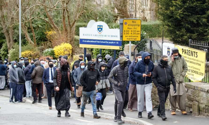 Protesters gathering outside Batley grammar school in Batley, west Yorkshire.