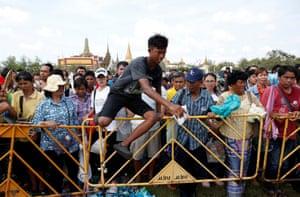 Bangkok, Thailand: A boy jumps over barriers