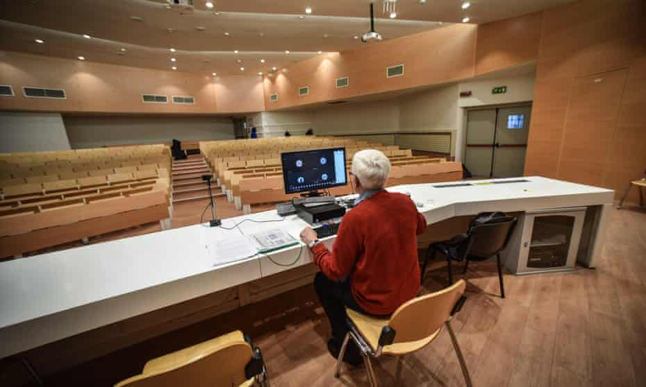 A college professor holds online lecture from an empty classroom in Milan.