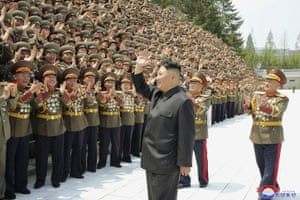 Pyongyang, North Korea: The North Korean leader, Kim Jong-un, waves to participants in a workshop of the commanders and political officers of the Korean People's Army