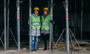 The co-founders of the Give Life Association, Oana Gheorghiu (R) and Carmen Uscatu, pictured at the hospital construction site