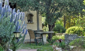 Image of the garden with wicker chair and table at To the Garden, Paros, Greece