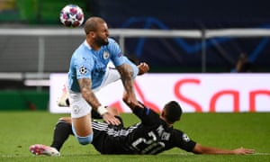 Manchester City's Kyle Walker is tackled by Lyos' Fernando Marcal.