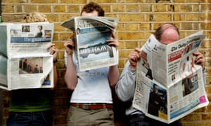 Three people reading different shaped newspapers at a bus stop