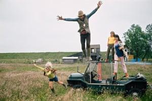 Ed van der Elsken jumps of his mini Moke vehicle during the recording of his film De Verliefde Camera', Edam 1970
