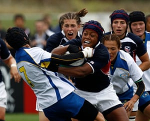 Phaidra Knight of the U.S. shakes off a tackle from Kazakhstan's Irina Radzivil at the 2010 World Cup in England.
