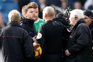 Pochettino remonstrates with referee Mike Dean after the match