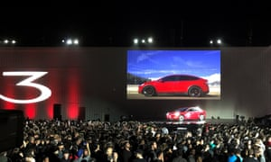 Tesla introduces one of the first Model 3 cars off the Fremont factory's production line on Friday night.