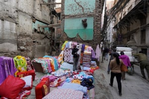Bedding salesman takes over space left by a collapsed building in Kathmandu