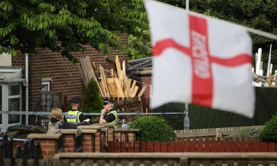 Police guard Thomas Mair's home after the killing of Jo Cox.
