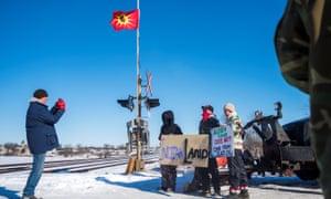 Indigenous members of the Tyendinaga Mohawk Territory block train tracks in Belleville, Ontario.