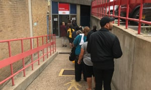 A queue at Royal Mail's Peckham delivery office in London.