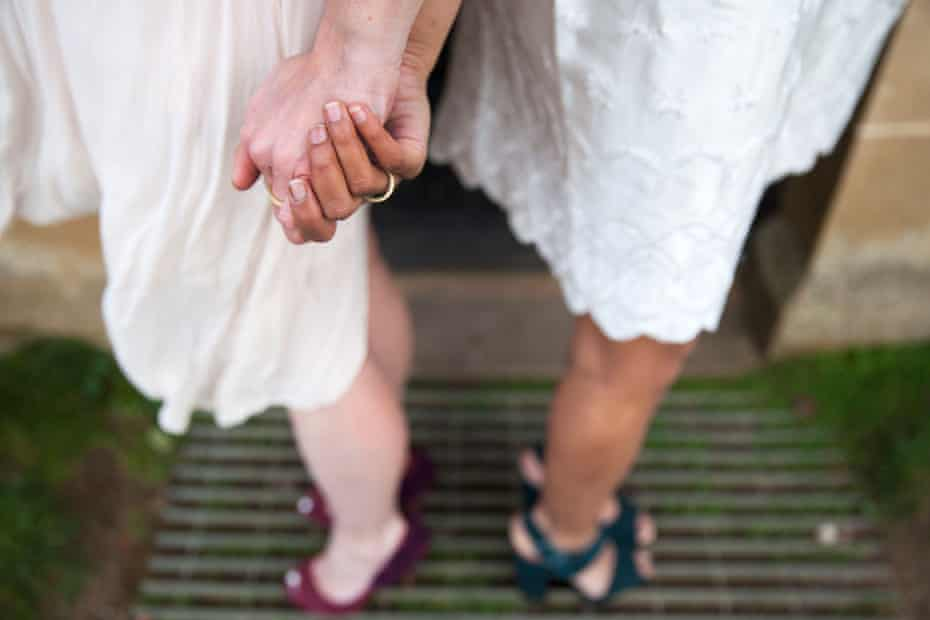 'The white wedding is a Victorian invention' … brides holding hands.