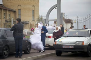 A wedding party in front of the Holy Ascension Cathedral