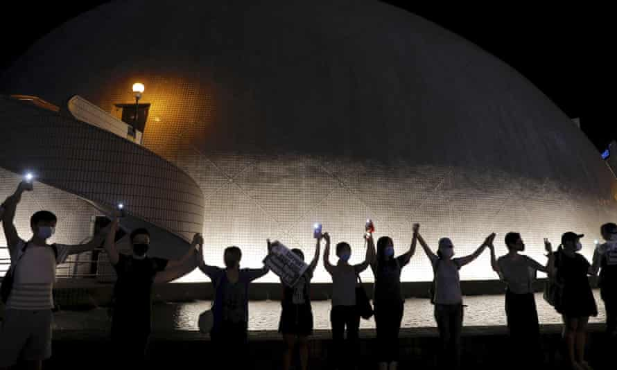 Protesters join hands outside the Hong Kong Space Museum