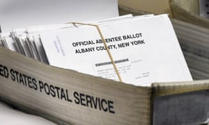 In this June 30, 2020, file photo, a box of absentee ballots wait to be counted at the Albany County Board of Elections in Albany, N.Y.