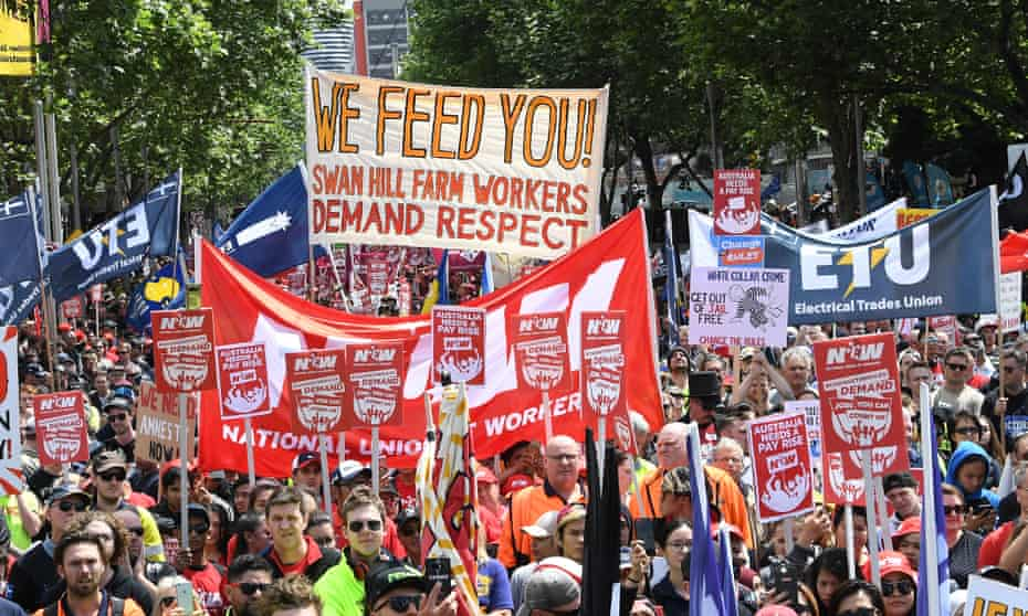 Protesters march in Melbourne as part of the 'Change the Rules' rally organised by the ACTU