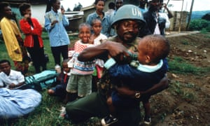 A UN soldier feeds a a child in May 1994 in Rwanda.