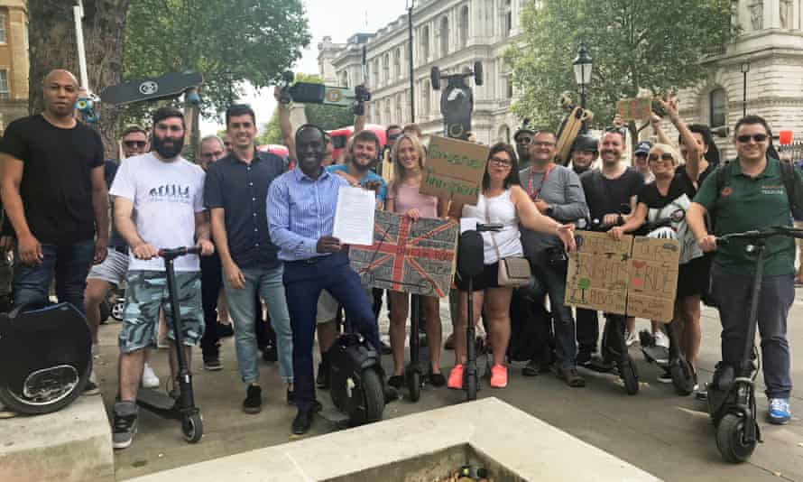 Demonstrators outside Downing Street calling for the legalisation of e-scooters on UK roads.