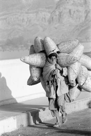 """Afghanistan, December 1966Boy with Baskets """"I was fascinated with Afghanistan. Its people and the land itself seemed to be created to endure the impossible. Every aspect of this land seemed to have been cut from something hard."""""""