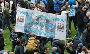 Manchester City fans display a banner to their owner at the Etihad Stadium after winning their second Premier League title in 2014.