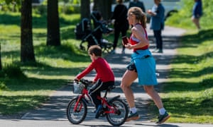 A runner with a child in London during lockdown.