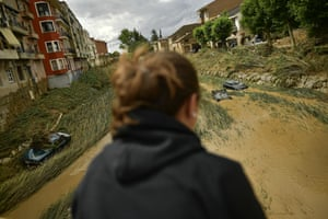 Cars are partially submerged in a flooded area in Tafalla, Spain, after flash flooding caused by intense and sudden downpours.