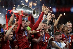 Liverpool players celebrate after winning the Champions League final match against Tottenham Hotspur at the Wanda Metropolitano stadium, 2 June, Madrid